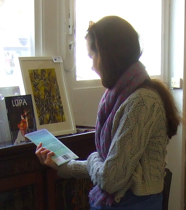A visitor checking out books at 'Reading Corner'.